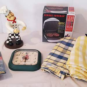 Lot #316 - George Foreman Grill, Clock, Tablecloths, Kitchen Fire Extinguisher and Goofy Chef Statue