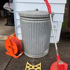 Lot #324 - Toro 900 Electric Trimmer, Extension Cord, Galvanized Garbage Can, Sprinkler
