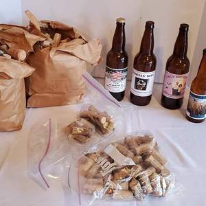 Lot #335 - Over 5 Dozen Clean Wine and Beer Bottles and Sacks of Corks