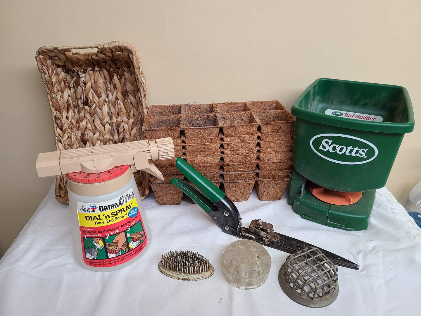 Lot#110 - Scotts Hand Spreader * Dial 'n Spray by Ortho * Garden Stuff * Shallow Basket with tag (main image)