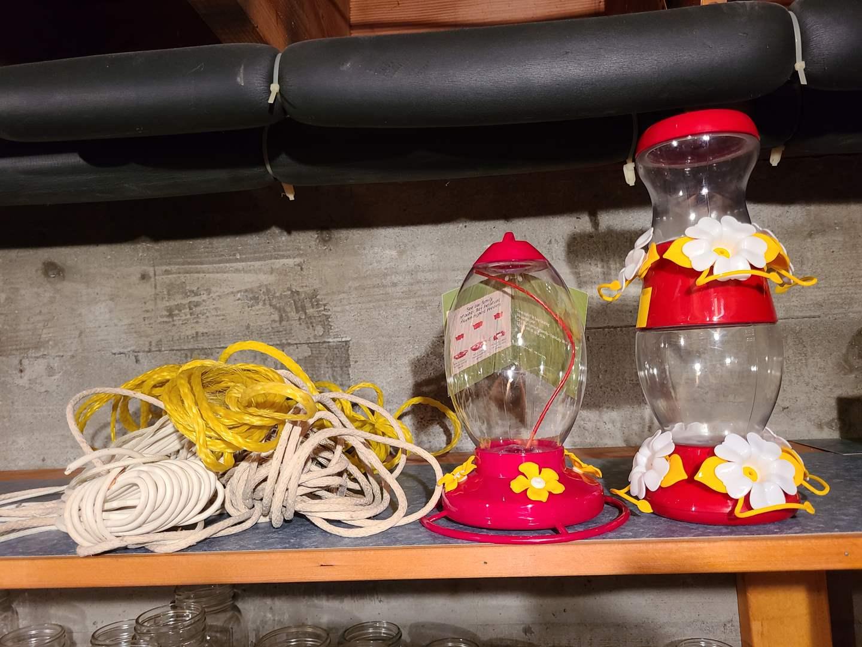 Lot#133 - 2 new Hummingbird Feeders with Plenty of Cord to hang them! (main image)