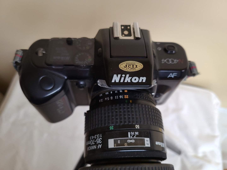 Lot#143 - Nikon N4004 with * AF Nikkor 35-70mm Lense * Tripod (main image)
