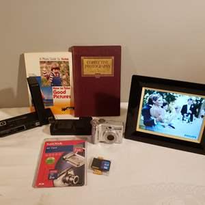 Lot # 113 - Photography Lot * Canon Power Shot A550 * Phillips Electric Frame * Scan Discs * Vtg. Kodak Camera * Photo Books