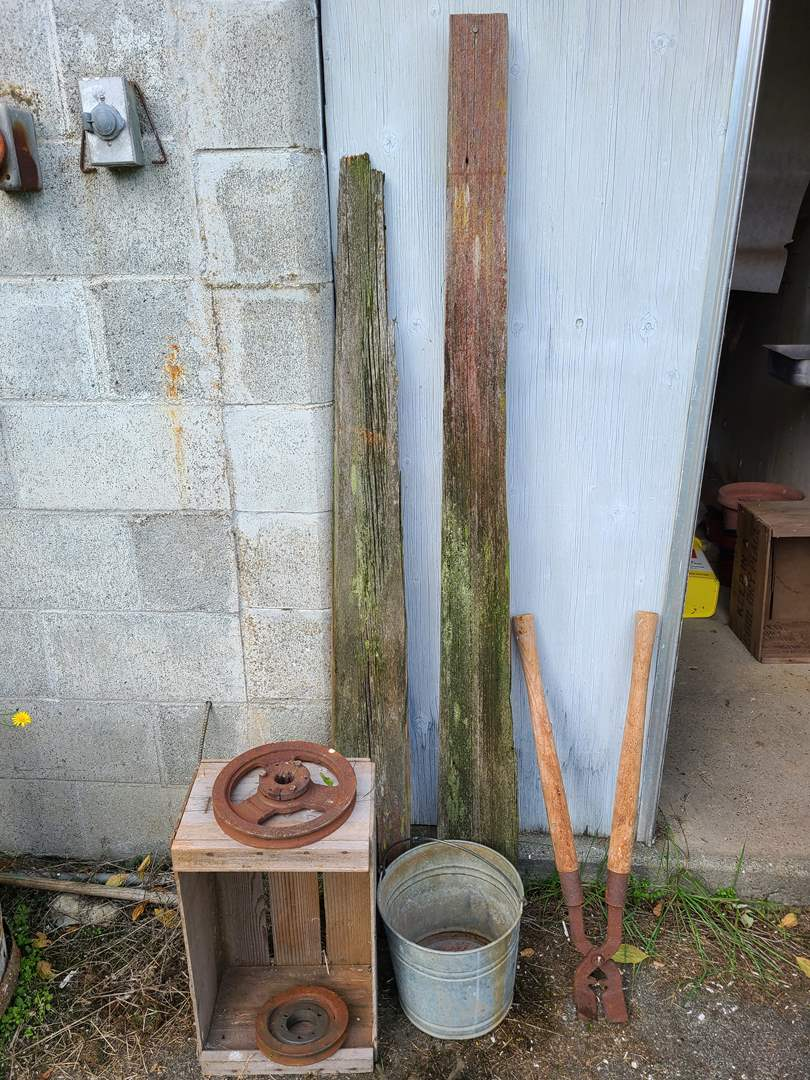 Lot # 21 - Outdoor Farm Stuff * 2 Pieces Reclaimed Wood from Barn * Metal Bucket * 2 Rusty Metal Reels or wheels (main image)
