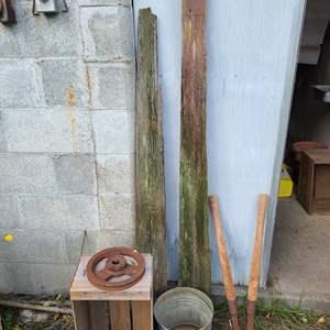 Lot # 21 - Outdoor Farm Stuff * 2 Pieces Reclaimed Wood from Barn * Metal Bucket * 2 Rusty Metal Reels or wheels
