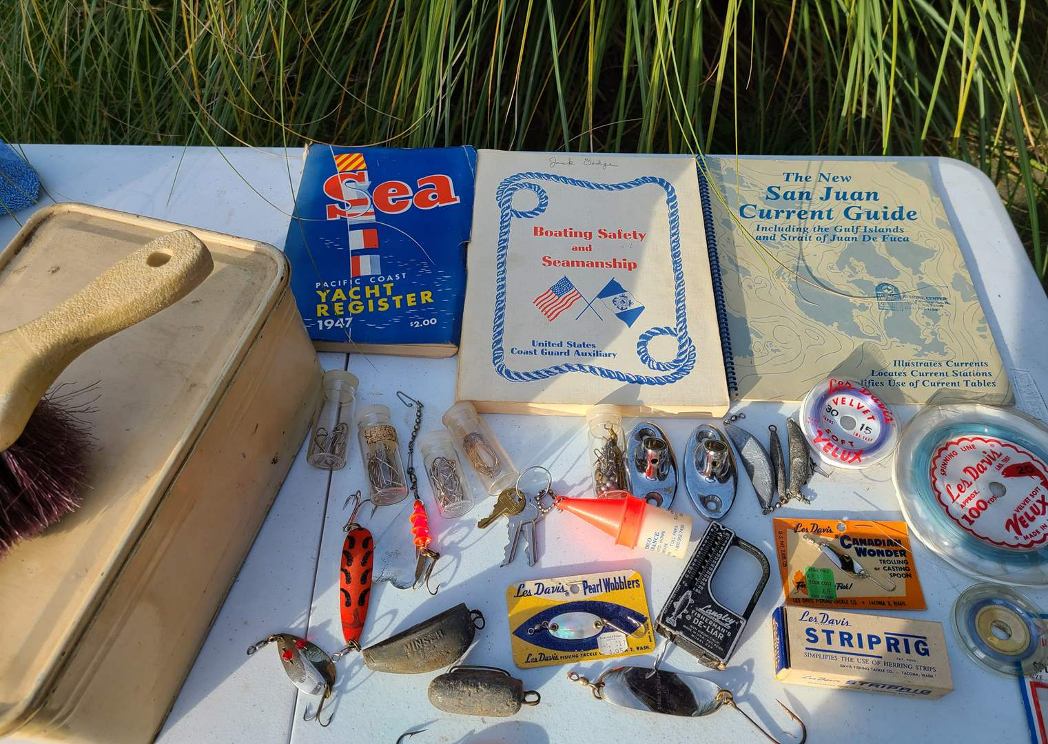 Lot # 26 - Boating / Fishing Lot * 1947 Pacific Coast Yacht Rigister * Fish Scale * Lures & Weights * San Juan Current Guide (main image)