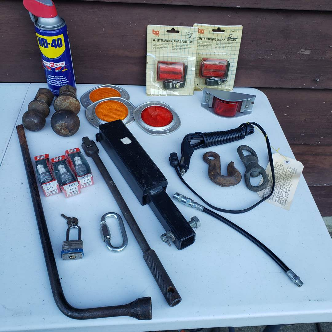 Lot # 33 - Tool Auto Lot * Reflector Lights * Hitch Balls * Receiver * Tow Hooks * Spark Plugs * WD40 (main image)