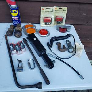Lot # 33 - Tool Auto Lot * Reflector Lights * Hitch Balls * Receiver * Tow Hooks * Spark Plugs * WD40