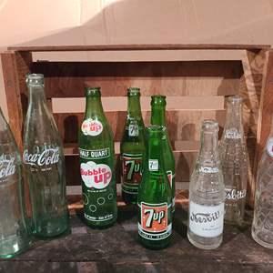Lot # 46 - Vintage Bottles * Bubble Up * 7UP * Pepsi * Coke * Nesbitts