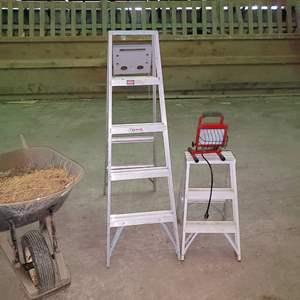 Lot # 70 - 2 Ladders * Wheelbarrow * Flood light