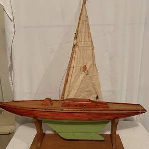 Auction Thumbnail for: Lot #64 - Hand Made Wood Sailboat Model with Fabric Sail on Wood Stand