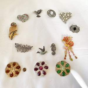 Lot #106- Brooch Collection. Qty 10. One has a loose stone.