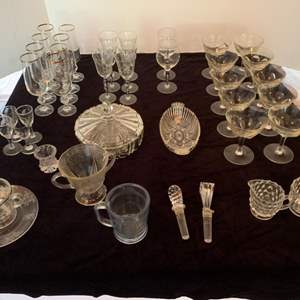Lot #31 - Crystal and Glass Serving Pieces, Cups, Glassware, Covered Dish, Ice Bucket & More
