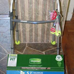 Lot #89 - Invacare Walker and Men's Depends