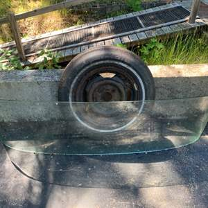 Lot #97 - Curved Glass Boat Windshield and Bias-Ply Trailer Tire