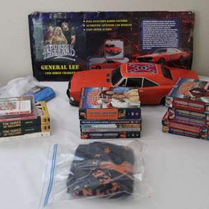 Lot #25 - Radio Controlled Car (not working) and Vintage Dukes of Hazzard and Starsky & Hutch VHS