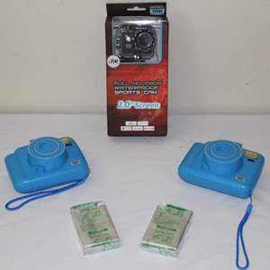 Lot #26 - Full HD 1080P Waterproof Sports Camera, Two Sharper Image Instant Cameras and Fuji Film