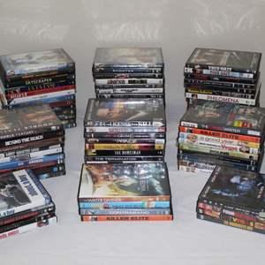 Lot #27 - Selection of DVDs: Last Man Standing,  Star Trek, Tru Grit, Passengers & More