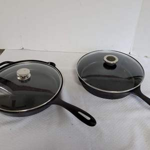 Lot #61 - Two Covered Cast Iron Skillets: Wagner & Victoria