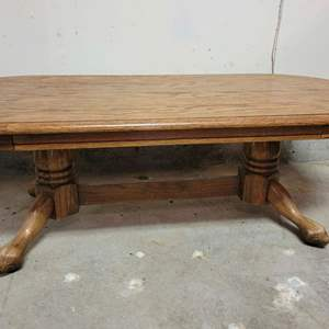 Lot #2 - Oval Oak Coffee Table with Heavy Base, Claw Feet. Has Surface Issues