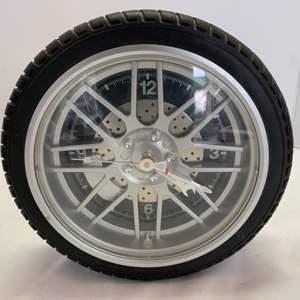 Lot #99 - Sterling and Noele Wheel Tire Wall Clock