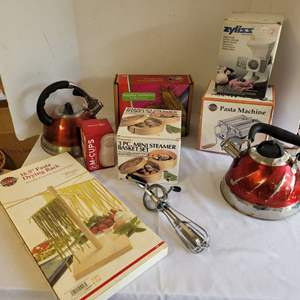 Lot #105 - Pasta Machine & Drying Rack, M-Cups, Two Tea Kettles, Meat Mincer, Tortilla Presser & More
