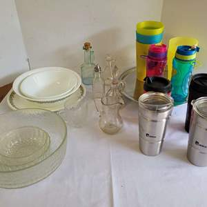 Lot #122 - Vintage Corelle Serving Pieces, Stainless Cups, Chrome Tray, Glass Serving and More