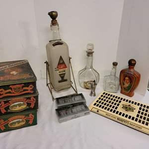 Lot #172 - U.S. Army Mess Gilbey's Swinging Gin Dispenser, Tins, Jack Daniels Bottles, Murphy's Irish Stout Advertising