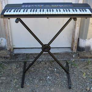 Lot #212 - Casio Electronic Keyboard Piano Model # CTK-480 with Stand (Missing Cords)