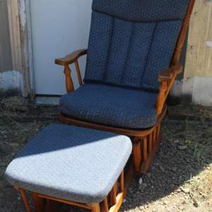 Lot #215 -  Wood Gliding Chair and Ottoman with Blue Fabric Cushions