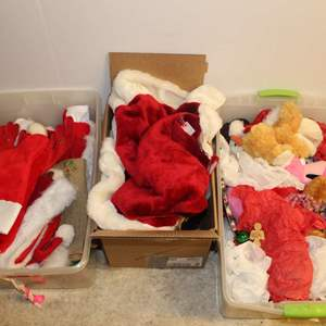 Lot #235 - Selection of Holiday Plush Animals and Decor, Stockings, Santa Hat and More