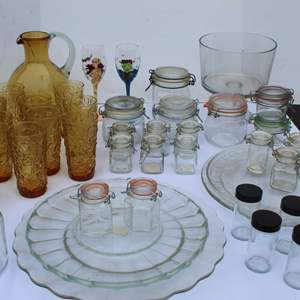 Lot #251 - Vintage Gold Glassware, Covered Jars, Glass Plates, Amber Glass Pitcher and More