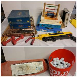 Lot #297 - Selection of Board Games, Hand Weights, Badminton/Volleyball Game Set, Bucket of Golf Balls