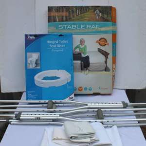Lot #313 - Medical Wraps, Crutches, Hinged Toilet Seat Riser and Bed Cane Stable Rail