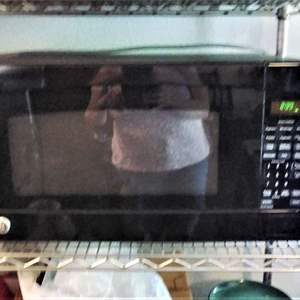 Lot #50 - Nice and Clean Working GE Microwave Oven