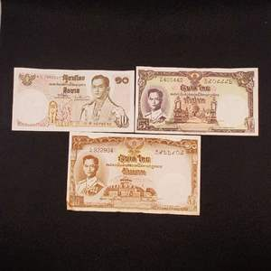 Lot 63 - Three Vintage Thai Baht Banknotes depicting King Rama IX