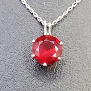 """Lot 78 - 8mm Red Stone Sterling Silver pendant Stamped 925, Made in India and 16"""" Sterling Silver Chain"""
