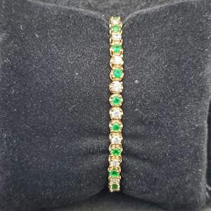 """Lot 79 - Vintage 7"""" Yellow Bracelet set with 3mm green and white stones."""