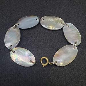 """Lot 81 - 7 1/2"""" Carved Mother of Pearl Shell Bracelet, reversible."""