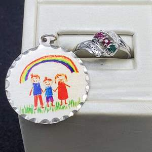 Lot 90 - Salesman's Sample Size 6 ring and Happy Family Pendant