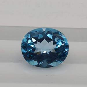 Lot 91 - 5.81ct Genuine Blue Topaz 12 x 10mm Oval Faceted Gemstone for Jewelry Making