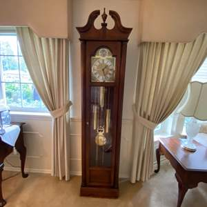 Lot # 2- Howard Miller Grandfather Clock. Has not been used in a while. Size in pic.