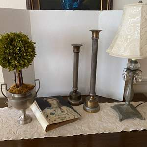 Lot # 28- Tasteful Home Decor: Lamp with Crystal Drop Accents, Candle Sticks, Photo Album, Topiary Urn, Runner.
