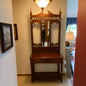 Lot # 41- Vintage Carved Wood Hall Tree with Table, Drawers, Brass Hooks and Pulls, Beveled Mirror.