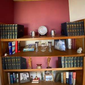 Lot # 47- 1964 Encyclopedia Americana Set, Wood Carved Statues, Brass Items, Pewter Chalices, Steins and Plate, Hardbacks, More.