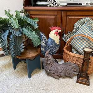 Lot # 54- Two Wood Carved Roosters, Country Pillow, Basket, Wood Stool and Faux Plant, Candle Stick.
