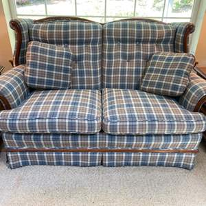 Lot # 62- Early American Loveseat with Wood Trim. It was covered with furniture covers so looks like new condition.