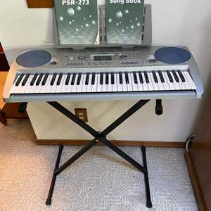 Lot # 70- Yamaha Computer Keyboard (the stand is wobbly). Song Books. Tested, Works great!