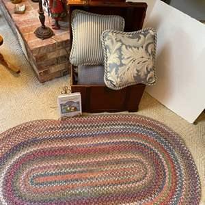 "Lot # 77- Braided Rug 36x60"", Accent Pillows, Decorative Trunk (Latch Broken)."