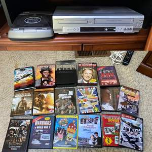 Lot # 83- Sylvania DVD Player, VHS Rewinder, Band of Brothers Boxed DVD and More Movies.